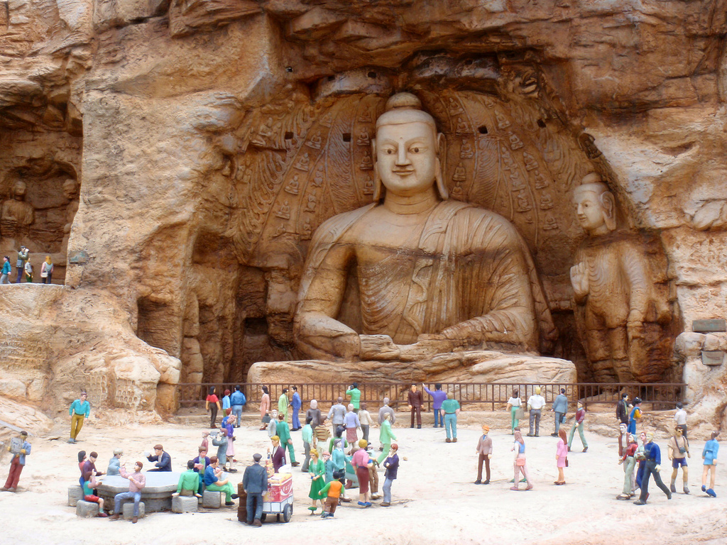 Picture from famousWonders.  The Mogao Caves or Mogao Grottoes (Chinese: 莫高窟; pinyin: Mògāo kū), also known as the Caves of the Thousand Buddhas (Chinese: 千佛洞; pinyin: qiān fó dòng), form a system of 492 temples 25 km (16 mi) southeast of the center of Dunhuang, an oasis strategically located at a religious and cultural crossroads on the Silk Road, in Gansu province, China. The caves may also be known as the Dunhuang Caves, however, this term is also used as a collective term to include other Buddhist cave sites in the Dunhuang area, such as the Western Thousand Buddha Caves, and the Yulin Caves farther away. The caves contain some of the finest examples of Buddhist art spanning a period of 1,000 years. The first caves were dug out in 366 CE as places of Buddhist meditation and worship. The Mogao Caves are the best known of the Chinese Buddhist grottoes and, along with Longmen Grottoes and Yungang Grottoes, are one of the three famous ancient Buddhist sculptural sites of China.