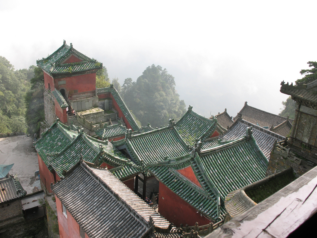 "Picture from Wikimedia. The Wudang Mountains (simplified Chinese: 武当山; traditional Chinese: 武當山; pinyin: Wǔdāng Shān) consist of a small mountain range in the northwestern part of Hubei, China, just south of Shiyan. They are home to a famous complex of Taoist temples and monasteries associated with the god Xuan Wu. The Wudang Mountains are renowned for the practice of Taichi and Taoism as the Taoist counterpart to the Shaolin Monastery, which is affiliated with Chinese Chán Buddhism.  On Chinese maps, the name ""Wudangshan"" (Chinese: 武当山) is applied both to the entire mountain range (which runs east-west along the southern edge of the Han River, crossing several county-level divisions of Shiyan), and to the small group of peaks located within Wudangshan subdistrict of Danjiangkou, Shiyan. It is the latter specific area which is known as a Taoist center."