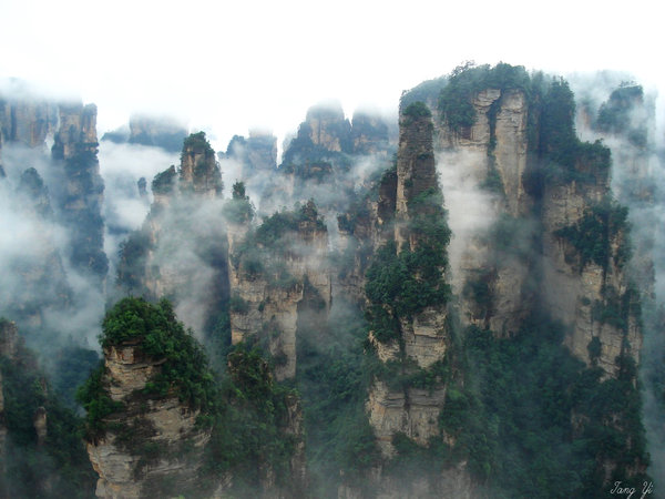 "Picture from tang_yi.  The Zhangjiajie National Forest Park (Chinese: 湖南张家界国家森林公园; pinyin: Húnán Zhāngjiājiè Guójiā Sēnlín Gōngyuán; literally: ""Hunan Zhangjiajie National Forest Park"") is a unique national forest park located in Zhangjiajie City in northern Hunan Province in the People's Republic of China. It is one of several national parks within the Wulingyuan Scenic Area.  According to park officials, photographs from Zhangjiajie inspired the floating Hallelujah Mountains seen in the film Avatar."