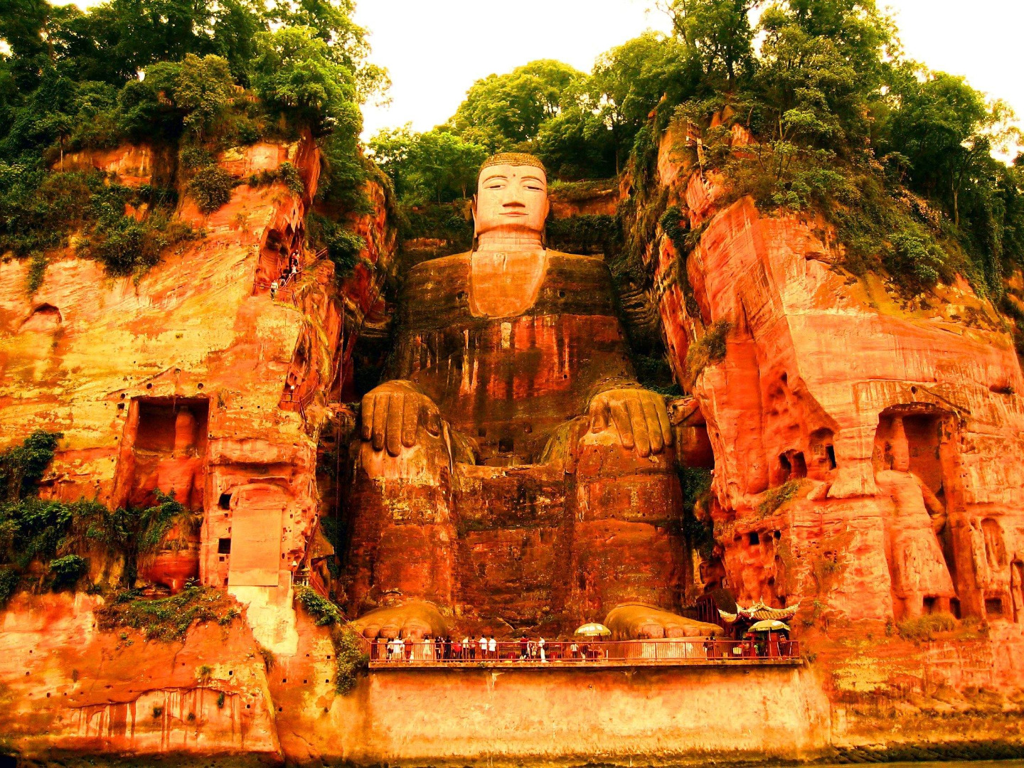 Picture from globeimages.   The Leshan Giant Buddha is a 71-metre (233 ft) tall stone statue, built during the Tang Dynasty. It is carved out of a cliff face that lies at the confluence of the Minjiang, Dadu and Qingyi rivers in the southern part of Sichuan province in China, near the city of Leshan. The stone sculpture faces Mount Emei, with the rivers flowing below his feet. It is the largest stone Buddha in the world and it is by far the tallest pre-modern statue in the world.  The Mount Emei Scenic Area, including Leshan Giant Buddha Scenic Area has been listed as a UNESCO World Heritage Site since 1996.
