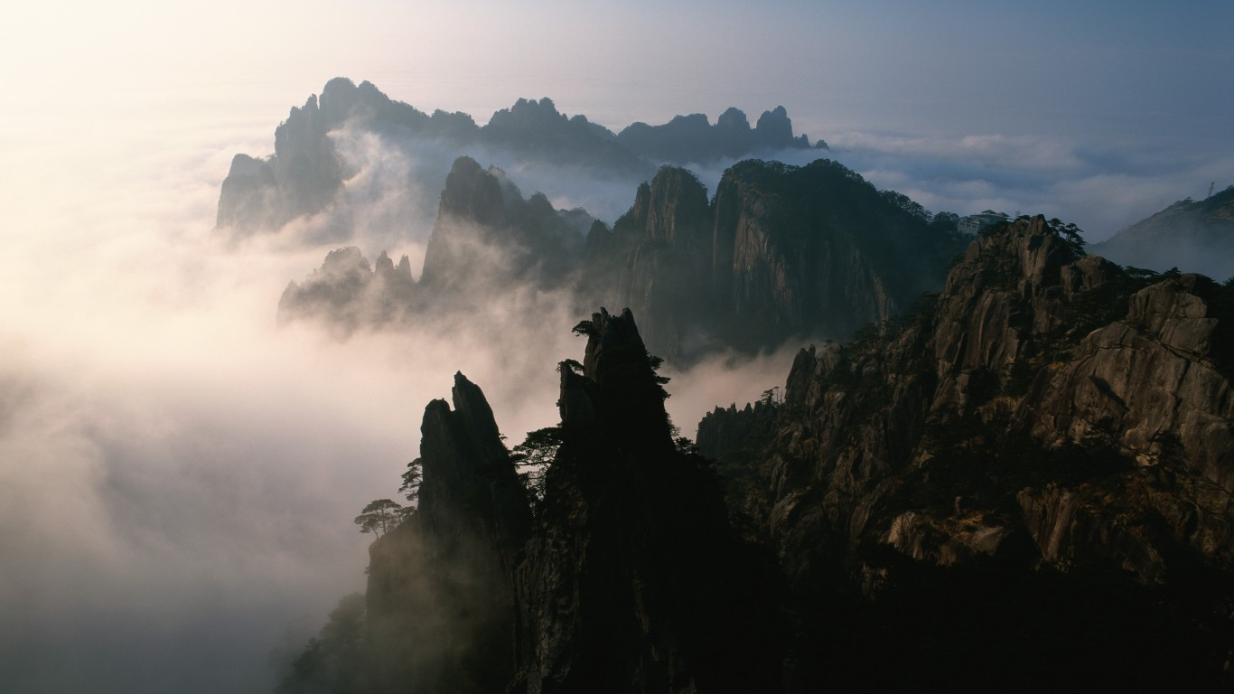 Picture from Scenery-wallpapers.  Mount Emei is one of the Four Sacred Buddhist Mountains of China, and is traditionally regarded as the bodhimaṇḍa, or place of enlightenment, of the bodhisattva Samantabhadra. Samantabhadra is known in Mandarin as Pǔxián Púsà (普賢菩薩).  16th and 17th century sources allude to the practice of martial arts in the monasteries of Mount Emei made the earliest extant reference to the Shaolin Monastery as Chinese boxing's place of origin.