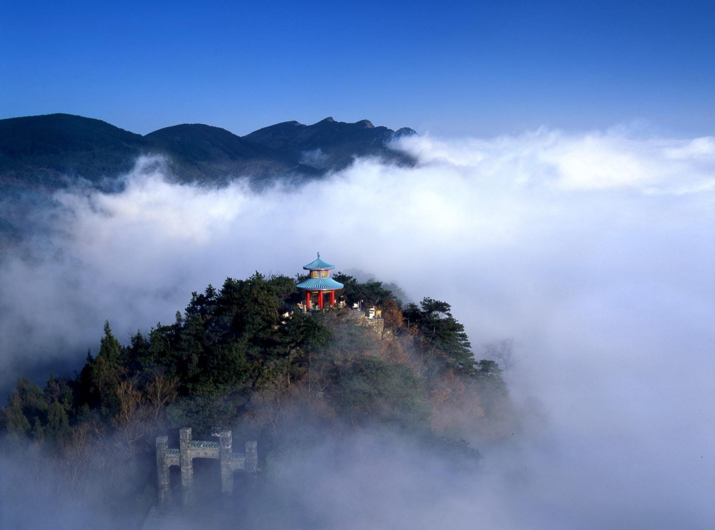Picture from globeimages. Mount Lu or Lushan (simplified Chinese: 庐山; traditional Chinese: 廬山; pinyin: Lúshān, Gan: Lu-san), also known as Kuanglu (匡庐) in ancient times, is situated in the northern part of Jiangxi province in southeastern China, and is one of the most renowned mountains in the country. The oval-shaped mountains are about 25 km long and 10 km wide, and neighbors Jiujiang city and the Yangtze River to the north, Nanchang city to the south, and Poyang Lake to the east. Its highest point is Dahanyang Peak (大汉阳峰), reaching 1,474 m above sea level, and is one of the hundreds of steep peaks that towers above a sea of clouds that encompass the mountains for almost 200 days out of the year. Mount Lu is known for its grandeur, steepness, and beauty, and is part of Lushan National Park, a UNESCO World Heritage Site since 1996, and a prominent tourist attraction, especially during the summer months when the weather is cooler.  Lushan was a summer resort for Western missionaries in China. Absalom Sydenstricker, the father of Pearl Buck was one of the first five missionaries to acquire property in the Kuling Estate on the mountain.