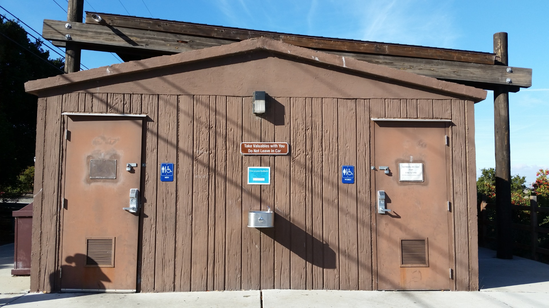 In regular business hours, it opens. If you cannot open the door and you are sure nobody is in the bathroom, wait a minute and hold the door knob, rotate to open the door.  If you still cannot open it, go to the visitor center to ask for help.